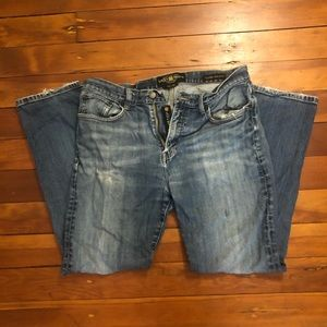 Distressed Lucky Brand men's or boyfriend jeans